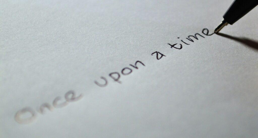 """Ein Stift schreibt """"Once upon a time"""""""